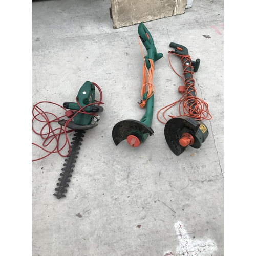 67 - THREE ITEMS - A QUALCAST HEDGE CUTTER AND TWO BLACK AND DECKER STRIMMERS ALL W/O...