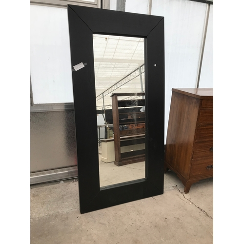 600 - A EXTRA LARGE BLACK FRAMED SHOP /DISPLAY MIRROR...