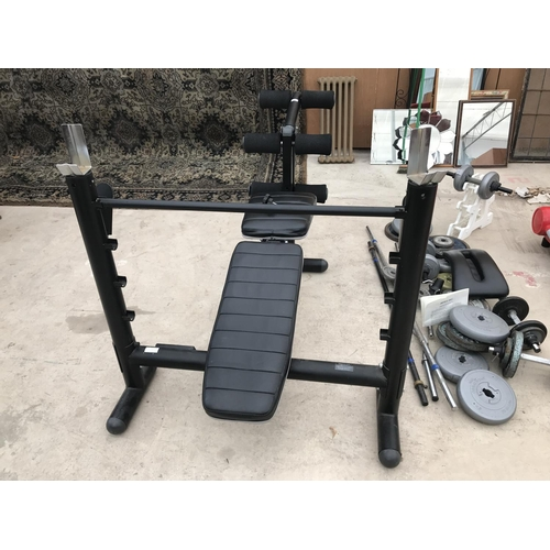 91 - A MARCY WEIGHT LIFTING BENCH WITH BARS AND WEIGHTS...
