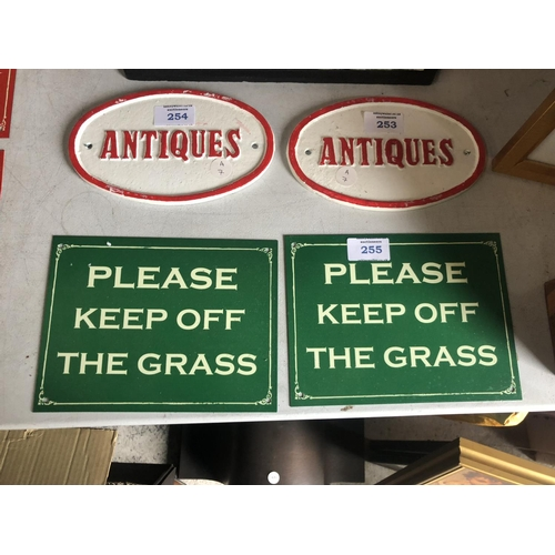 255 - TWO COLLECTABLE METAL 'PLEASE KEEP OFF THE GRASS' SIGNS (2)...