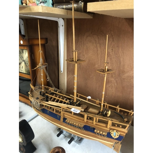 264 - A MODERN WOODEN HAND BUILT GALLEON SHIP ON STAND...