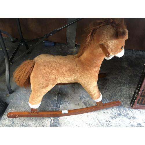 284 - A MODERN SOFT TOY CHILDS ROCKING HORSE WITH WOODEN BASE...