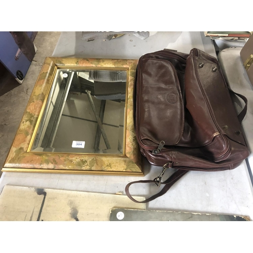 304 - A LEATHER CARRY BAG TOGETHER WITH FURTHER FLORAL FRAMED MIRROR (2)...