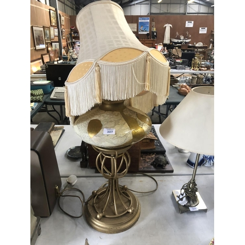 307 - A MODERN DESIGNER LAMP BASE WITH SHADE...