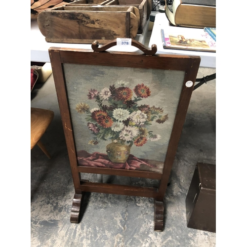 378 - A VINTAGE WOODEN FRAMED TAPESTRY FIRE SCREEN...