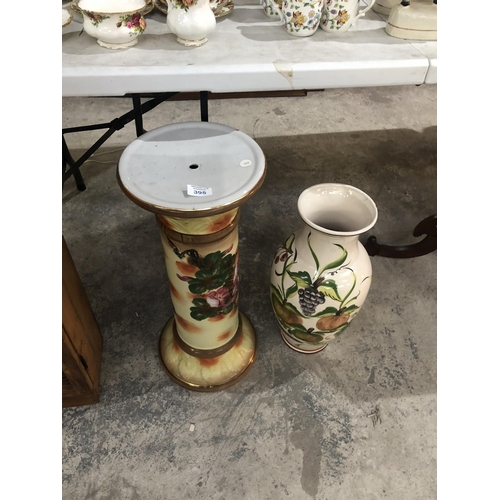 395 - A VICTORIAN STYLE CERAMIC JARDINIERE COLUMN STAND TOGETHER WITH FURTHER FLORAL VASE (2)...