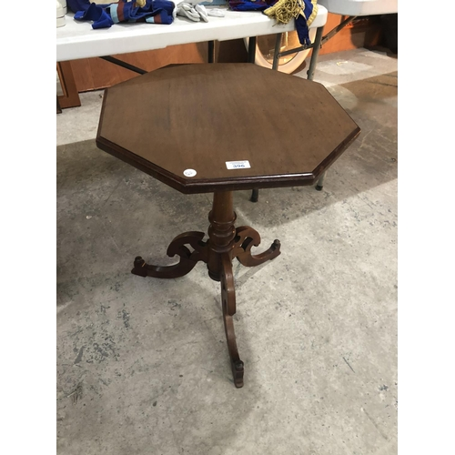 396 - A MAHOGANY OCTAGONAL TRIPOD TABLE WITH CARVED BASE SUPPORT...