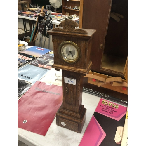 504 - A MINIATURE WOODEN CASED DOLLS GRANDFATHER CLOCK...