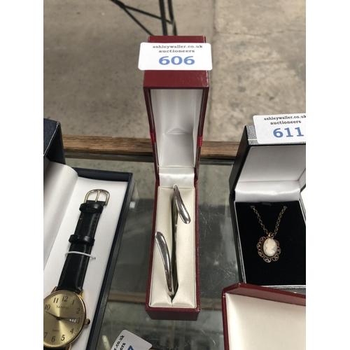 606 - A BOXED SILVER LADIES BANGLE...