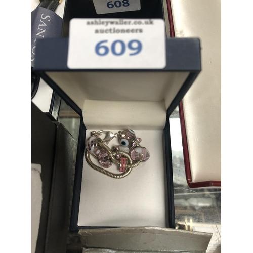 609 - A 'PANDORA STYLE' BRACELET, BOXED...