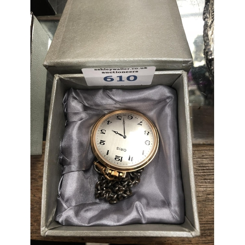 610 - A BOXED GOLD PLATED 'ORIS' POCKET WATCH AND CHAIN...