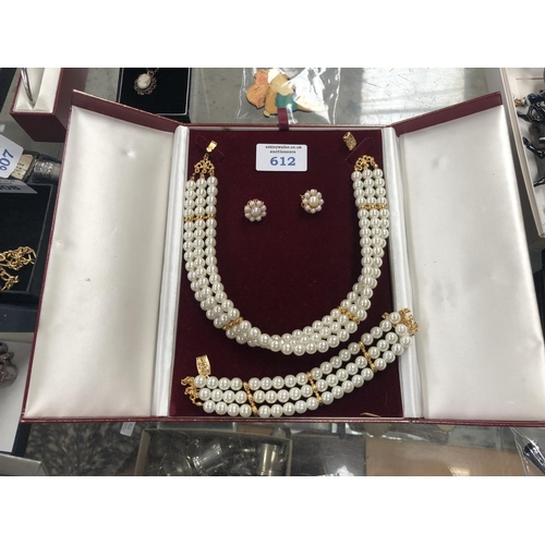 612 - A LADIES BOXED PEARL COSTUME JEWELLERY SET...