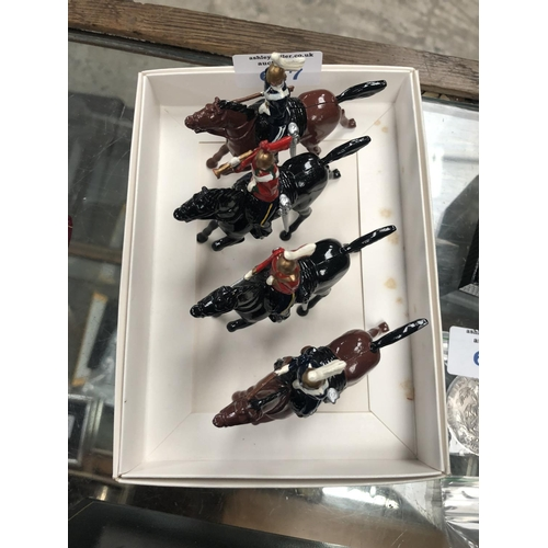 617 - FOUR VINTAGE 'BRITAINS' LEAD TOY SOLDIERS ON HORSEBACK FIGURES...
