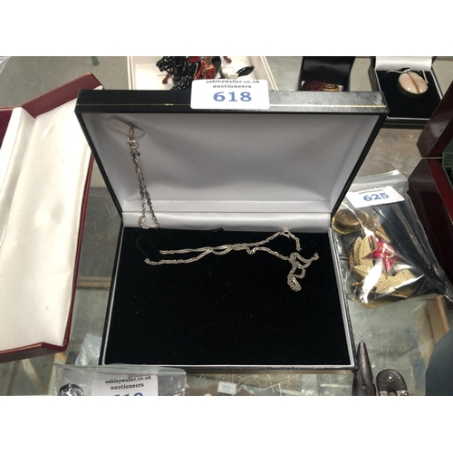 618 - A LADIES SILVER NECKLACE AND BRACELET BOXED SET...