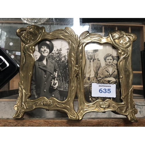 635 - A PAIR OF BRASS ARTS AND CRAFTS STYLE PHOTO FRAMES...
