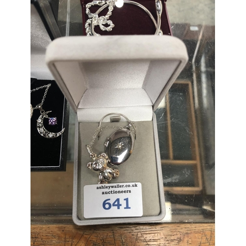 641 - TWO LADIES SILVER ITEMS TO INCLUDE TEDDY BEAR NECKLACE AND FURTHER NECKLACE (2)...