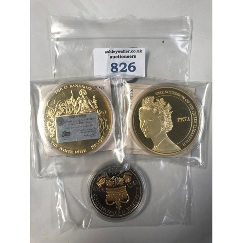 826 - TWO 50MM , GOLD PLATED MEDALS , ONE FEATURING THE ACCESSION AND THE OTHER BRITISH £5 WHITE BANKNOTE ...