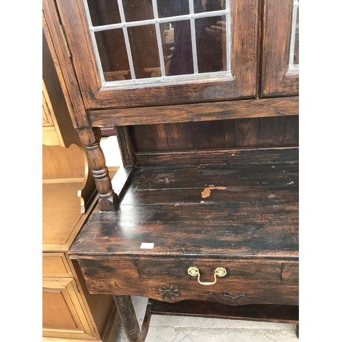 974 - AN OAK DRESSER WITH TWO DRAWERS AND TWO UPPER LEAD GLAZED DOORS...