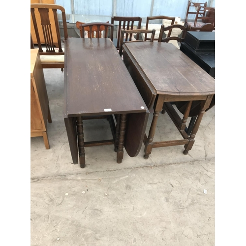 985 - TWO OAK DROP LEAF DINING TABLES...