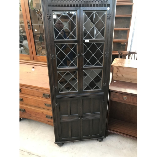 997 - A PRIORY OAK CORNER CUPBOARD WITH TWO LOWER DOORS AND TWO UPPER LEAD GLAZED DOORS...