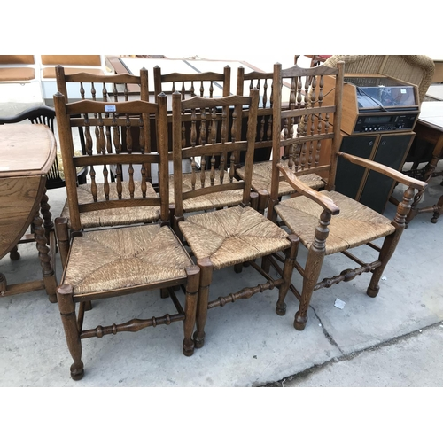 1016 - FIVE MACCLESFIELD OAK DINING CHAIRS WITH RUSH SEATS AND ONE CARVER...