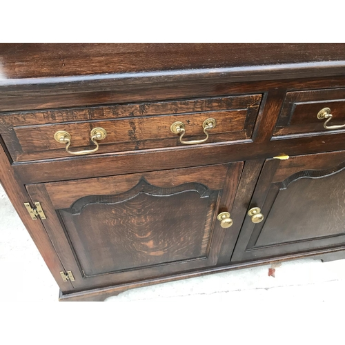 1080 - AN OLD CHARM STYLE OAK DRESSER WITH TWO DOORS, TWO DRAWERS AND UPPER PLATE RACK WITH TWO LEAD GLAZED...