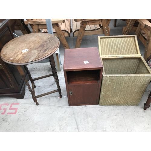 1083 - THREE ITEMS - A SMALL OAK TABLE, AN OAK BEDSIDE CABINET AND A LLOYD LOOM LUSTY LINEN BASKET...