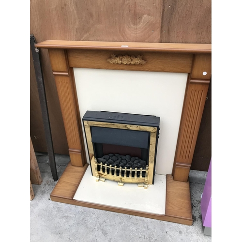 78 - A WOODEN FIRE SURROUND WITH ELECTRIC FIRE, HEARTH AND BACK...
