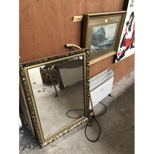 287 - A GILT FRAMED WATER COLOR OF A MOUNTAINOUS SEASCAPE TOGETHER WITH A FURTHER GILT FRAMED MIRROR (2)...