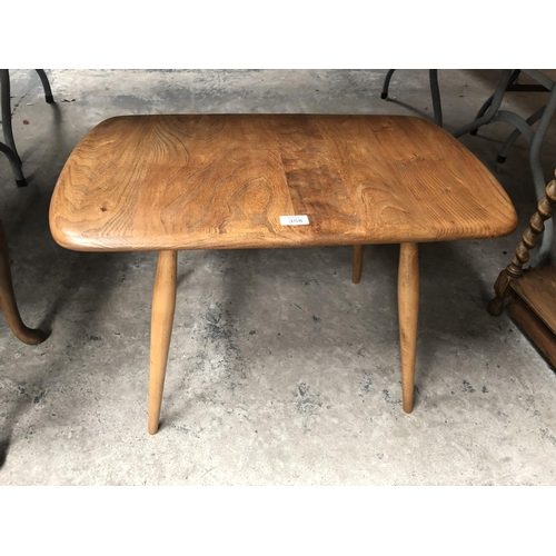 358 - AN ERCOL LIGHT ELM COFFEE TABLE...