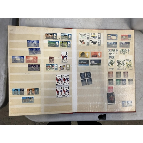 418 - A SELECTION OF GB UNMOUNTED MINT DECIMAL STAMPS HOUSED IN A RED STOCK BOOK, FACE VALUE OF £100+...