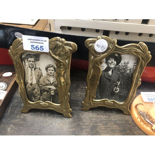 565 - A PAIR OF ART NOUVEAU STYLE BRASS PHOTO FRAMES...