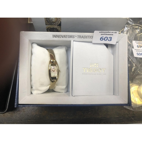 603 - A LADIES BOXED GOLD PLATED TISSOT WATCH WITH MOTHER OF PEARL DIAL...