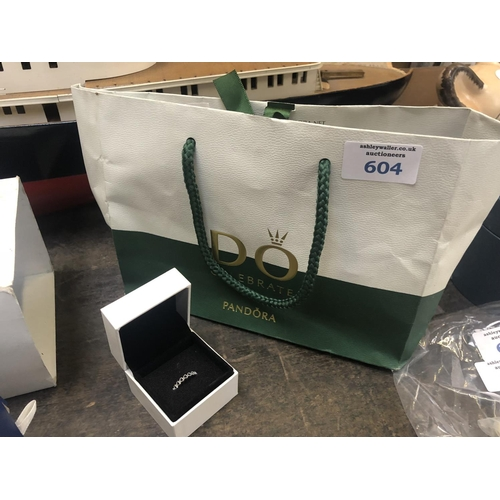 604 - A LADIES BOXED 'PANDORA' RING WITH RECEIPT AND BAG...