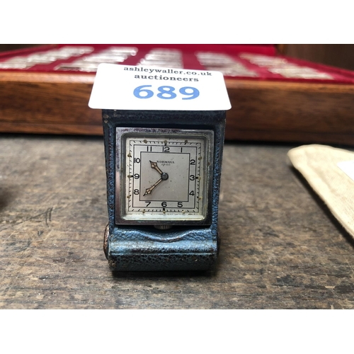 689 - A VINTAGE 'NORMANA' SWISS FOLDING TRAVEL CLOCK...