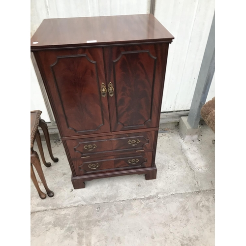821 - A MAHOGANY CABINET WITH TWO DOORS...
