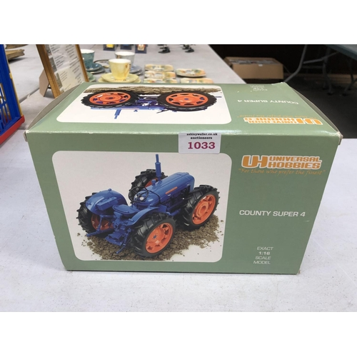 1033 - A BOXED UNIVERSAL HOBBIES FORD 'COUNTY SUPER 4' 1961 1:16 SCALE TRACTOR MODEL...
