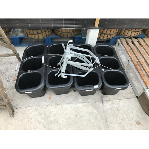 12 - FOUR PLASTIC CALF FEEDERS WITH THREE SECTIONS PER FEEDER WITH A TEAT FOR EACH AND FOUR GATE HANGERS...