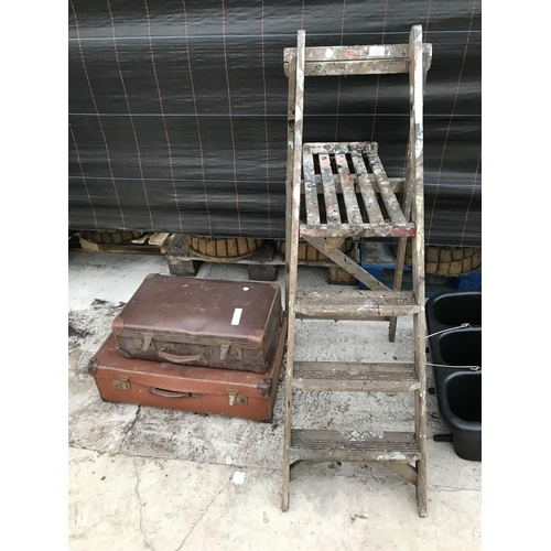 13 - A FOUR RUNG WOODEN STEP LADDER AND TWO VINTAGE SUITCASES...