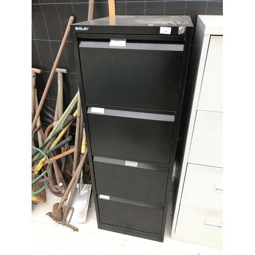 16 - A FOUR DRAWER LOCKABLE METAL FILING CABINET WITH KEY (KEY IN SAFE IN FURNITURE OFFICE)...