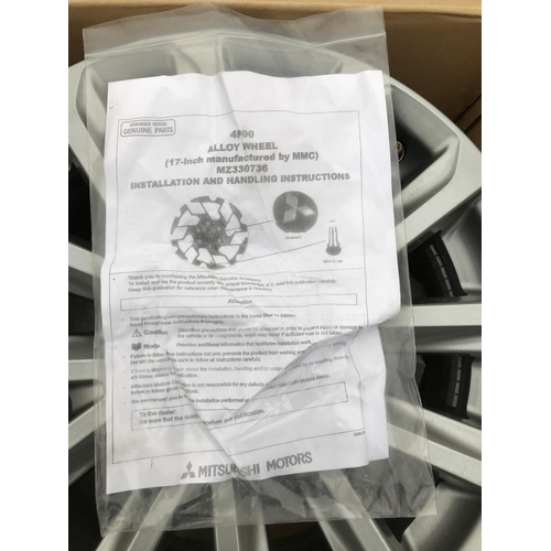 23 - AS NEW AND BOXED FOUR MITSUBISHI ALLOY WHEELS M2330736...