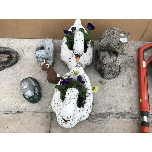 3 - SIX CONCRETE GARDEN ORNAMENTS TO INCLUDE A BADGER, TWO SWANS, OTTER, FOX, TOAD ETC...