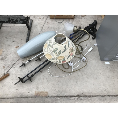 49 - TWO SETS OF TREZETA WALKING POLES, TWO LAMPS AND SHADES AND A LARGE GREY VASE W/O...