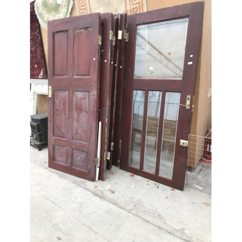 54 - SIX INTERIOR WOODEN DOORS 65CM X 204CM AND A GLAZED DOOR 92CM X 204CM (KEYS IN FURNITURE OFFICE)...
