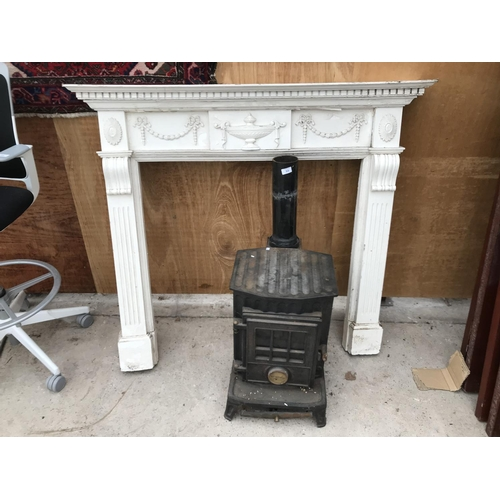 55 - A LOG BURNER EFFECT GAS STOVE APPROX 38CM X 57CM  WITH A CREAM WOODEN ORNATE FIRE SURROUND 133CM X 1...