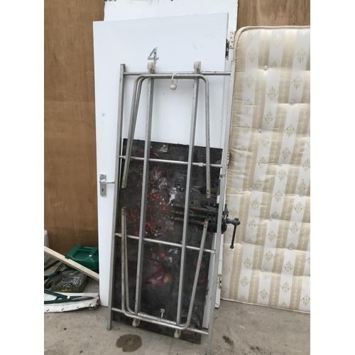 61 - TWO FIRE DOORS AND A METAL WORK BENCH WITH RECORD VICE ATTACHED...