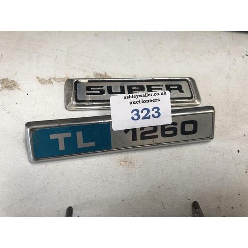 323 - A 'SUPER' CAR BADGE AND A 'TL 1260' BADGE (2)...