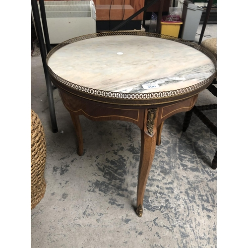 406 - A MARBLE TOPPED CIRCULAR INLAID TABLE...
