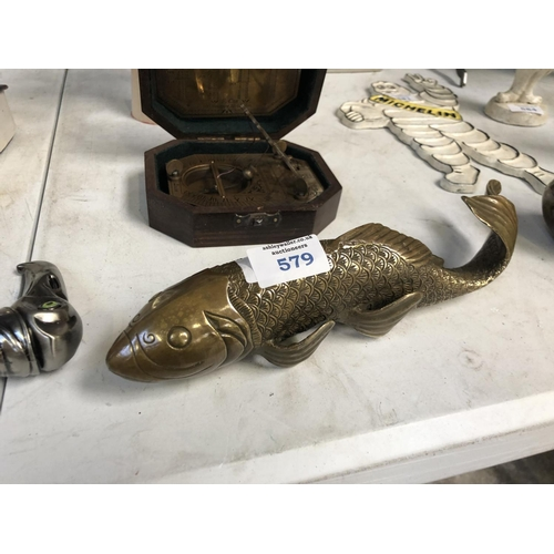 579 - AN ORIENTAL STYLE BRASS MODEL OF A FISH...