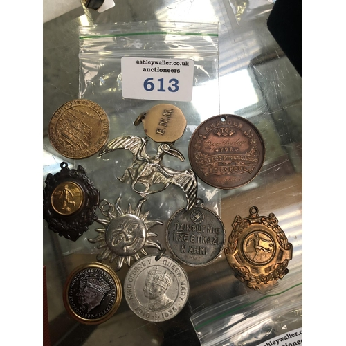 613 - TEN ASSORTED BADGES / TOKENS...